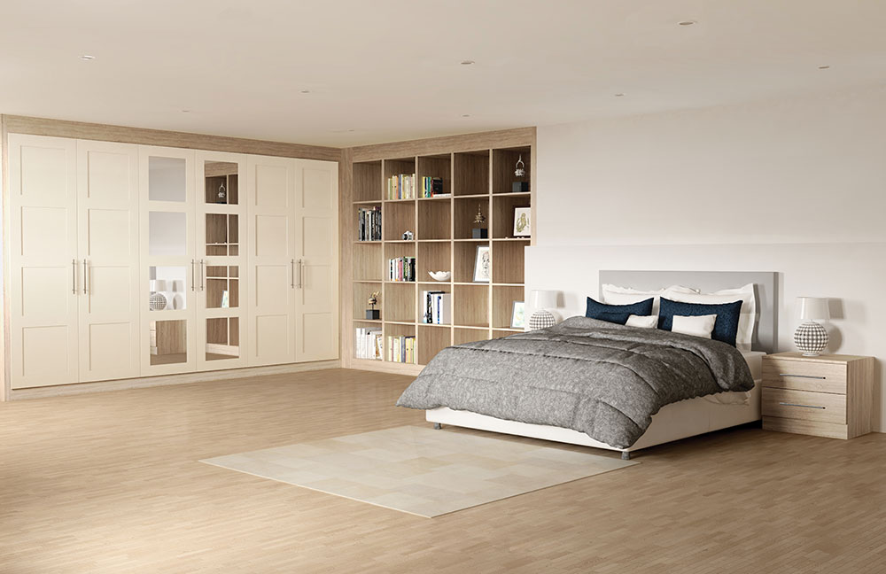 spacious bedroom with shelves and wardrobes